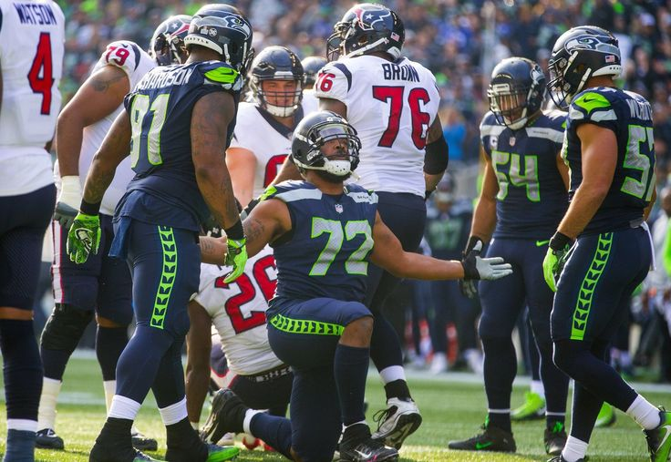 Seattle Seahawks defensive end Michael Bennett (72) celebrates a sack of Houston Texans quarterback Deshaun Watson (4) during 3rd quarter action. (Mike Siegel / The Seattle Times)