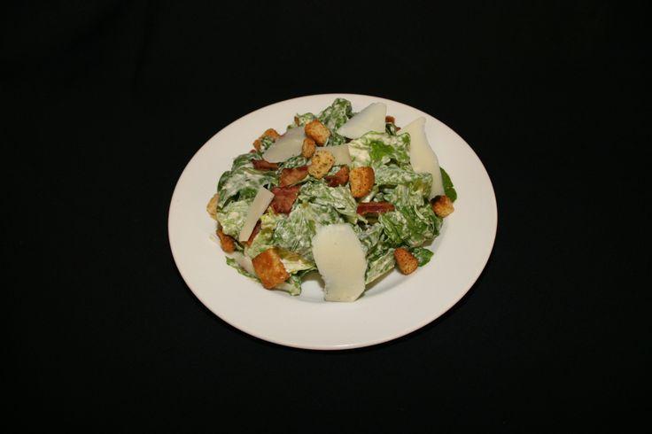 Frederick's Caesar - Fresh crisp romaine, bacon, seasoned croutons and parmesan shards tossed in Frederick's popular caesar dressing #caesarsalad