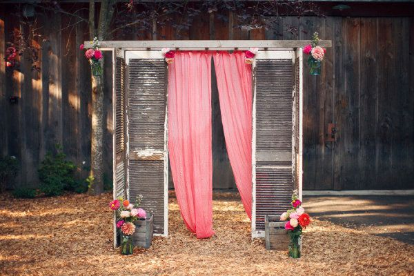 backdrop homemade from shutters and a vintage ladder