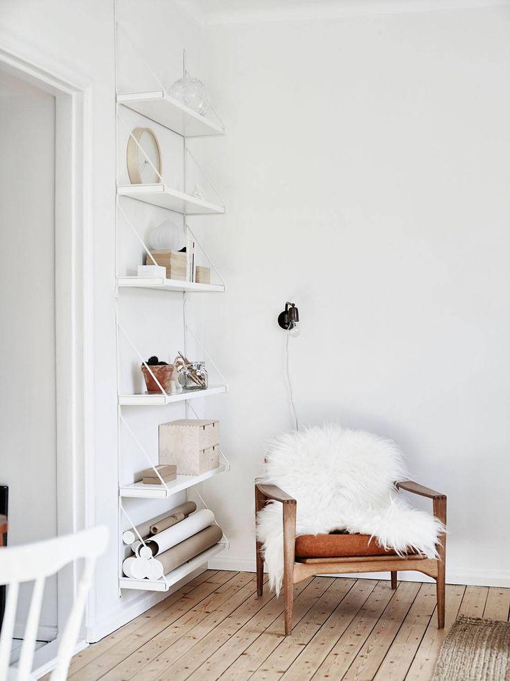 A beautiful and cozy Scandinavian reading corner.