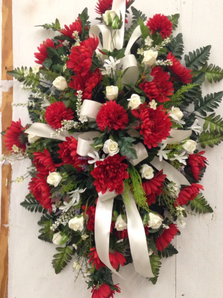 Red and white standing funeral spray by kelly columbia for A arrangement florist flowers
