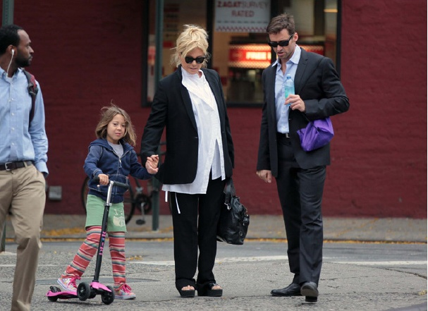 Hugh Jackman's little girl loves Skechers! Look at her scootin' along!