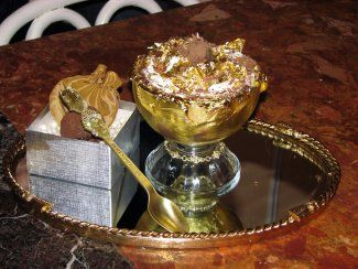 """$25,000 dessert!!! Its a """"frrozen haute chocolate"""" with cocoas from over 14 different countries and 5 grams of 24 carat gold in the dessert. The dish is decorated with diamonds and you get to keep the little gold spoon(well in that case its totally worth it!)"""