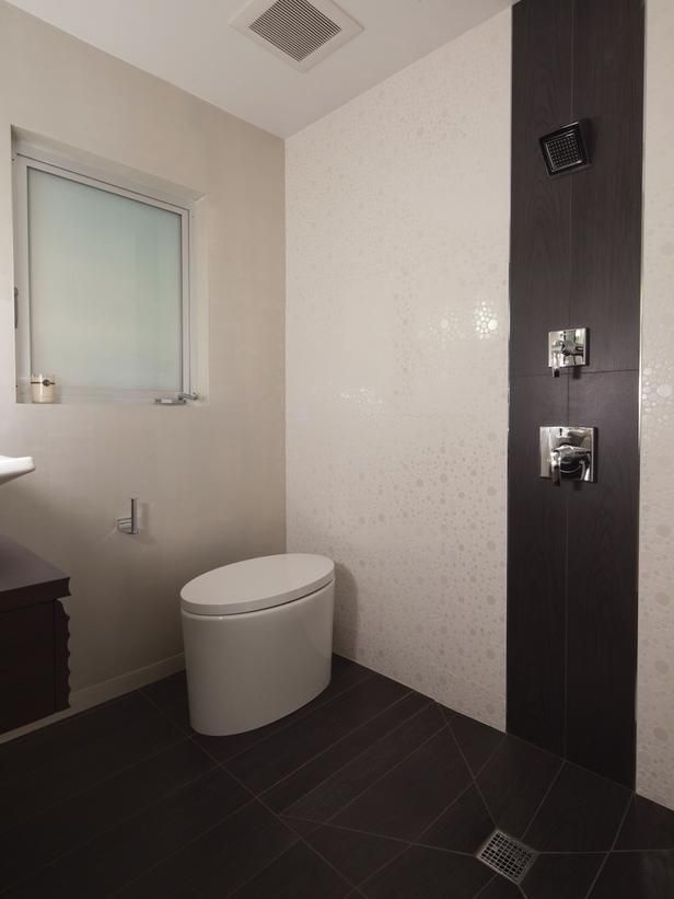 open concept bathroom eliminating a shower stall opened the expanse of the floor