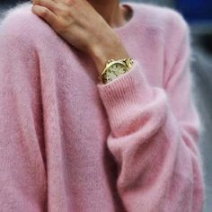 This pink sweater is beautiful all by itself. When braving bright colors, accessorize lightly with a simple gold watch.