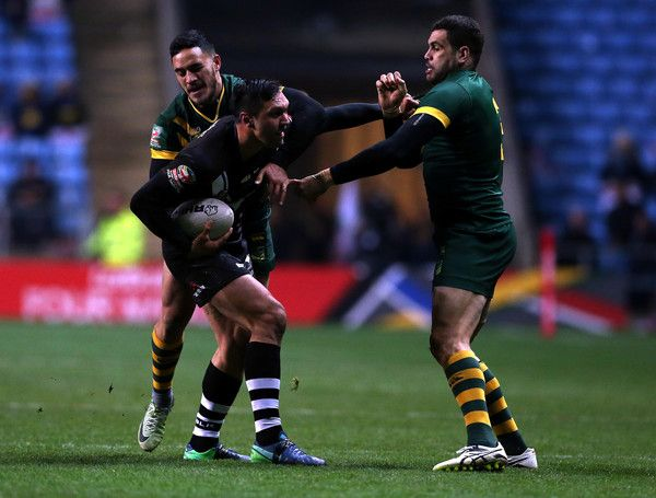 Canberra Raiders Jordan Rapana (C) of New Zealand Kiwis tackled byValentine Holmes (L) and Greg Inglis (R) of Australia Kangaroos during the Four Nations match between the New Zealand Kiwis and Australian Kangaroos at The Ricoh Arena on November 5, 2016 in Coventry, United Kingdom.