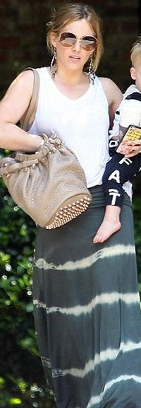 Who made Hillary Duff's studded handbag and tie dye maxi skirt? Skirt – Love Tanjane  Purse – Alexander Wang