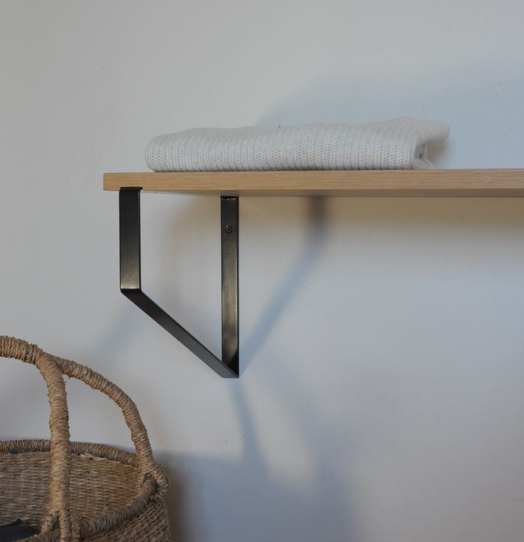 Oak Hikurangi shelf from Ico Traders.co.nz Solid white Oak with black wall brackets.