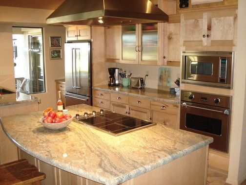GRanite - I love my granite countertops - but next time would choose slightly lighter with more drama - maybe something like this.