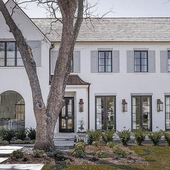 White Brick Painted Home with Dove Gray Shutters