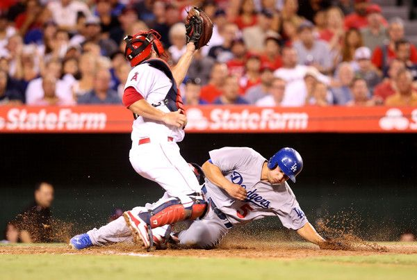 Corey Seager Photos Photos - Corey Seager #5 of the Los Angeles Dodgers slides home ahead of the throw to catcher Chris Iannetta #17 of the Los Angeles Angels of Anaheim to score a run on a fielder's choice in the sixth inning at Angel Stadium of Anaheim on September 8, 2015 in Anaheim, California. - Los Angeles Dodgers v Los Angeles Angels of Anaheim