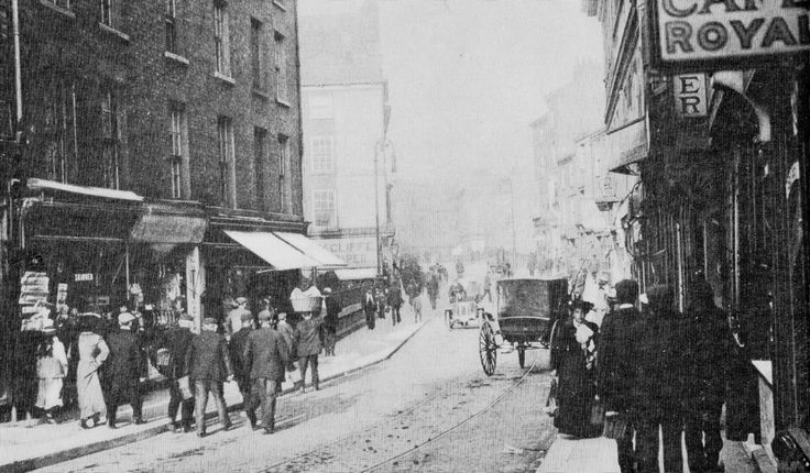 Micklegate, York as it becomes Bridge street  and the Ouse Bridge. 1910. Tram lines for horse drawn trams and a very early motor car.