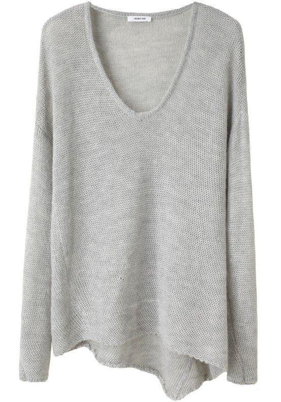 Grey soft loose sweater with asymmetric hem.