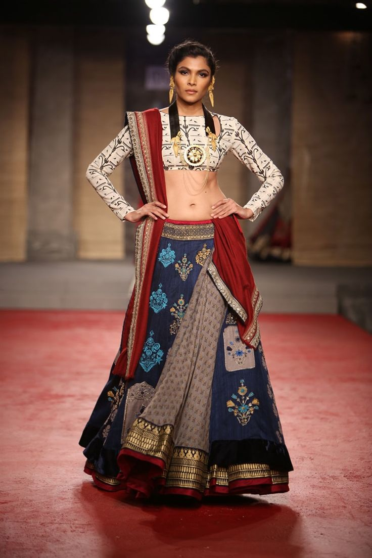 Anju Modi's 2013 Draupadi Collection reflects the designer's close ties with Hindu culture and religion as she dedicates her fashions to Draupadi from the Mahabharata epic saga. Draupadi was described as a virtuous, holy, and headstrong woman who was married to the five Pandavas brothers in the tale.
