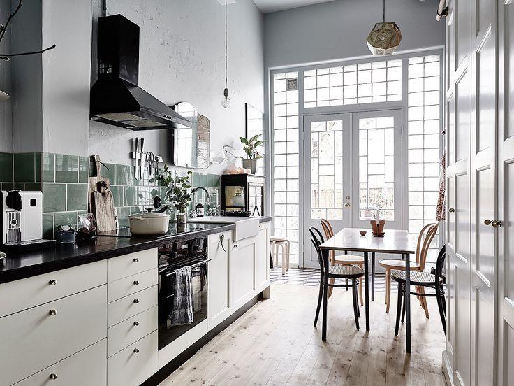 amazing fretwork French doors & green glass tile