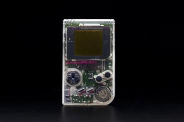 2012/73/1 Electronic toy, Game Boy, with case, game cartridges (3) and user manual, plastic / rubber / electronic components, designed by Gunpei Yokoi, made by Nintendo, Japan / China, 1995 - Powerhouse Museum Collection