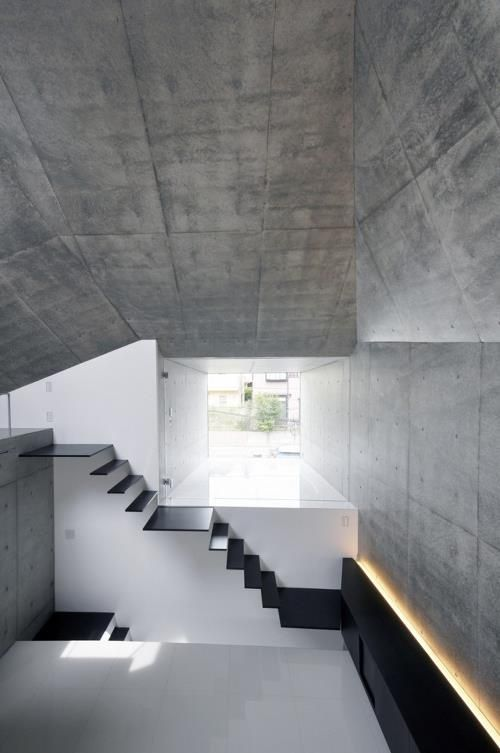 wall lighting >> Fuse-atelier designed this concrete monolith of a home in Abiko, Japan