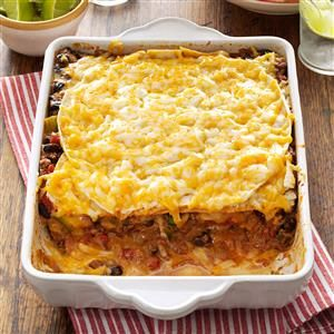 Taco Lasagna Recipe -If you like foods with Southwestern flair, this just might become a new favorite. Loaded with cheese, meat and beans, the layered casserole comes together in a snap. There are never any leftovers when I take this dish to potlucks. —Terri Keena, Tuscaloosa, Alabama