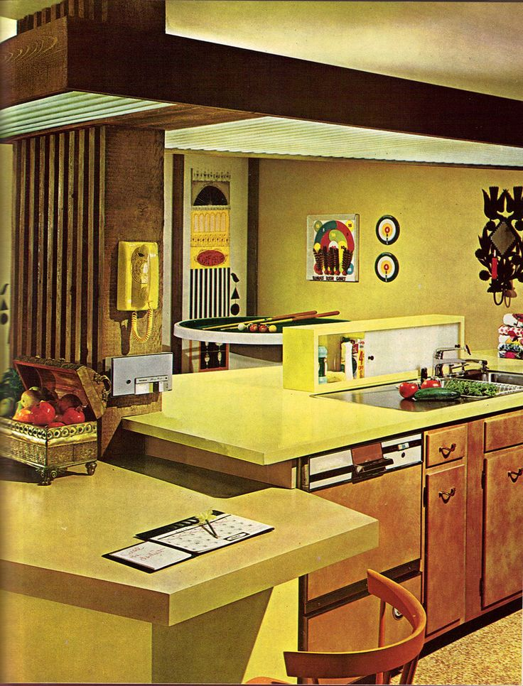 60's kitchen - awesome counters, check out the mini pool table, the sliding cupboard for dish soap.  Spoiled housewives!!