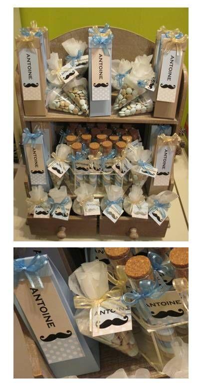 Populair 'snor' thema voor Antoine met blauwe en zandkleurige hoge doosjes, proefbuisjes en cornetto's met gepersonaliseerde labeltjes.