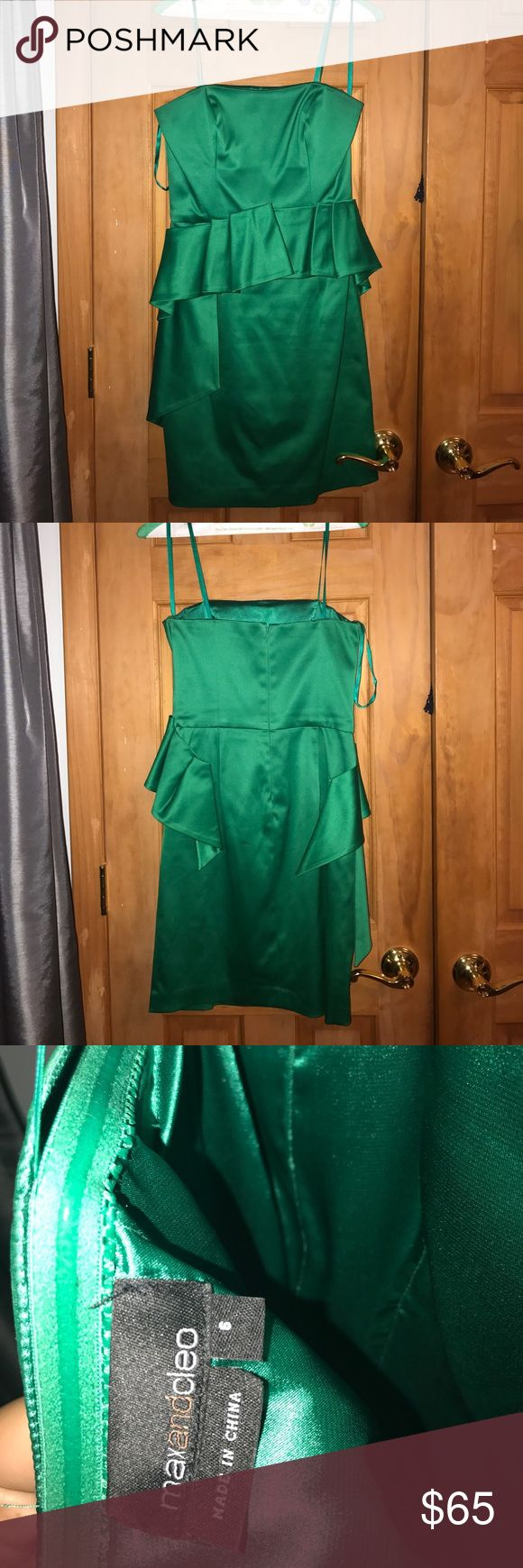 Max and Cleo emerald green strapless peplum dress Max and Cleo peplum strapless short dress. Emerald green. Extremely flattering. Hugs all the right curves !! Worn twice. NO pulls or stains on the dress. OPEN TO NEGOTIATIONS. Max and Cleo Dresses Strapless