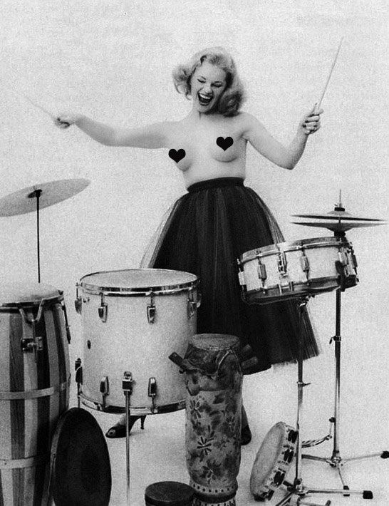 Naked Woman On Drums