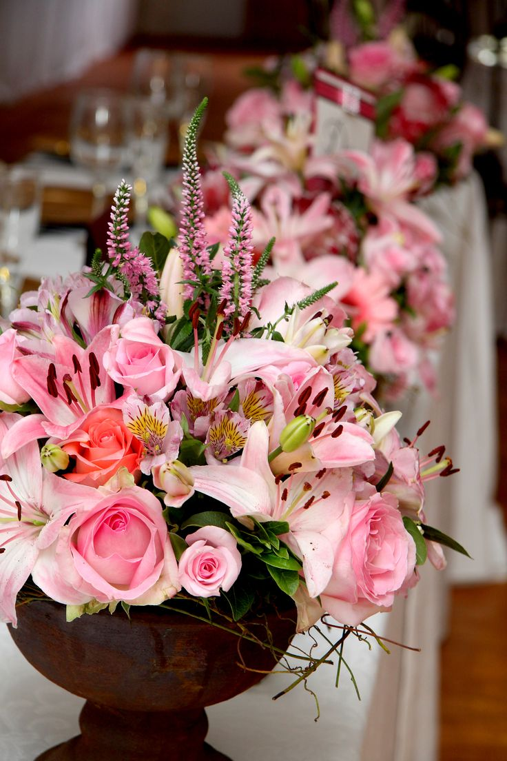 Roses and  Proteas and lilly flowers the perfect combination