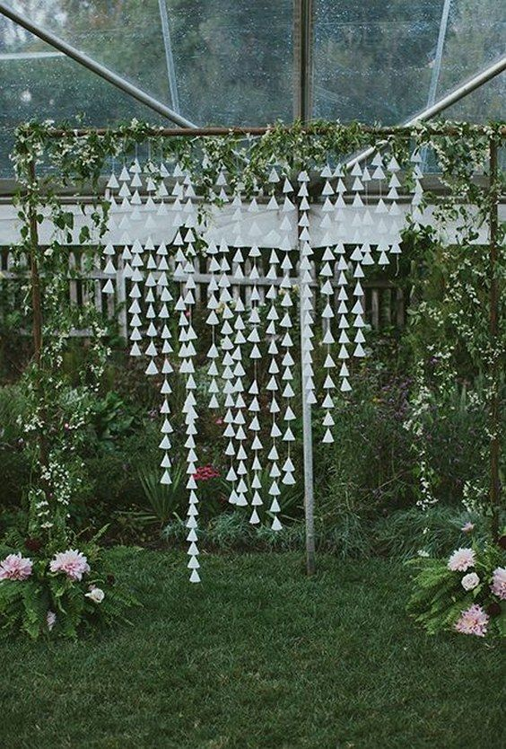 whimsical DIY ceremony altar wrapped in wild vines with hanging cone garlands / http://www.himisspuff.com/wedding-backdrop-ideas/9/