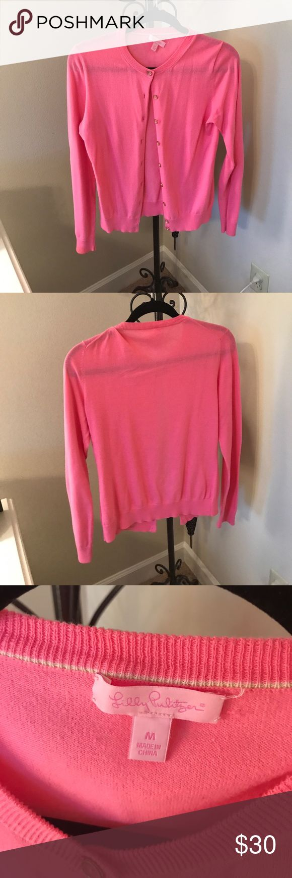 Lilly Pulitzer light pink cardigan Light pink cardigan from Lilly Pulitzer. Excellent condition, the tag did come loose the last time I had this cleaned but other than that it's in perfect condition with no signs of wear. Lilly Pulitzer Sweaters Cardigans