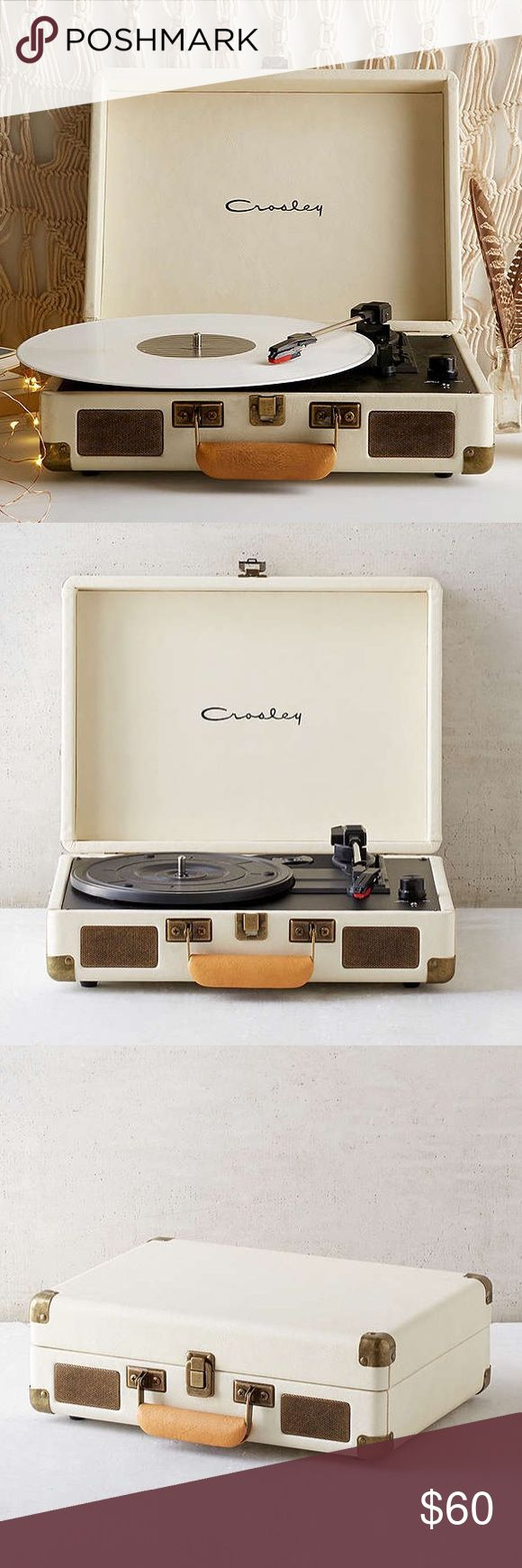 Crosley X UO Cruiser Cream Briefcase Record Player Crosley Record Player. Last photo contains actual product. No box, Fully working, purchased from Urban Outfitters. Works perfectly and adds an adorable addition to any decor, even when not in use. Only getting rid of it now so I can some of the money back in order to get the gold wireless edition they now sell. Comment any questions you have and I'll reply as soon as possible! Flexible on price on most items. Items purchased on or right…