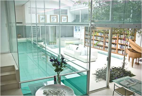 22 Amazing Indoor Pool Inspirations For Your Home library and pool what more do u need?