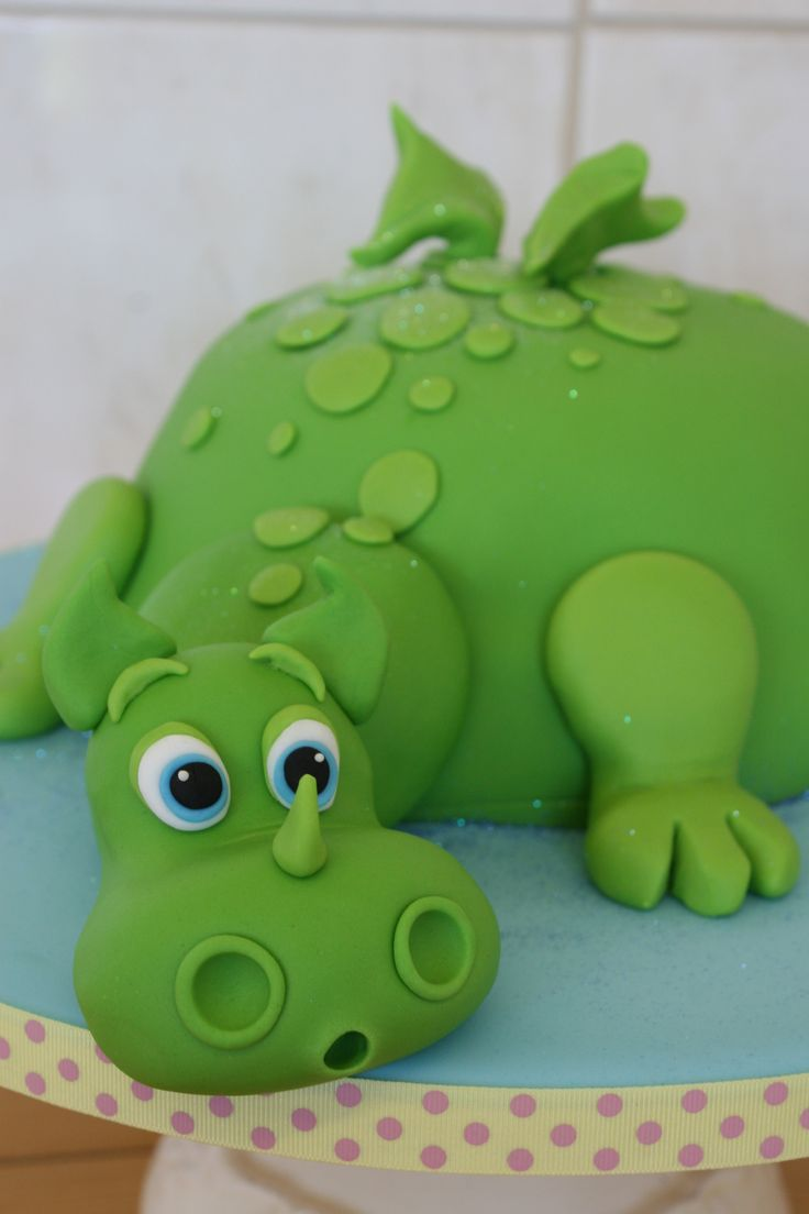 Dinosaur Popping Out Of Cake