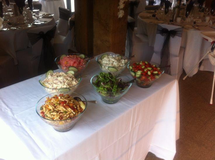 Various salads that accompany the hog roast.