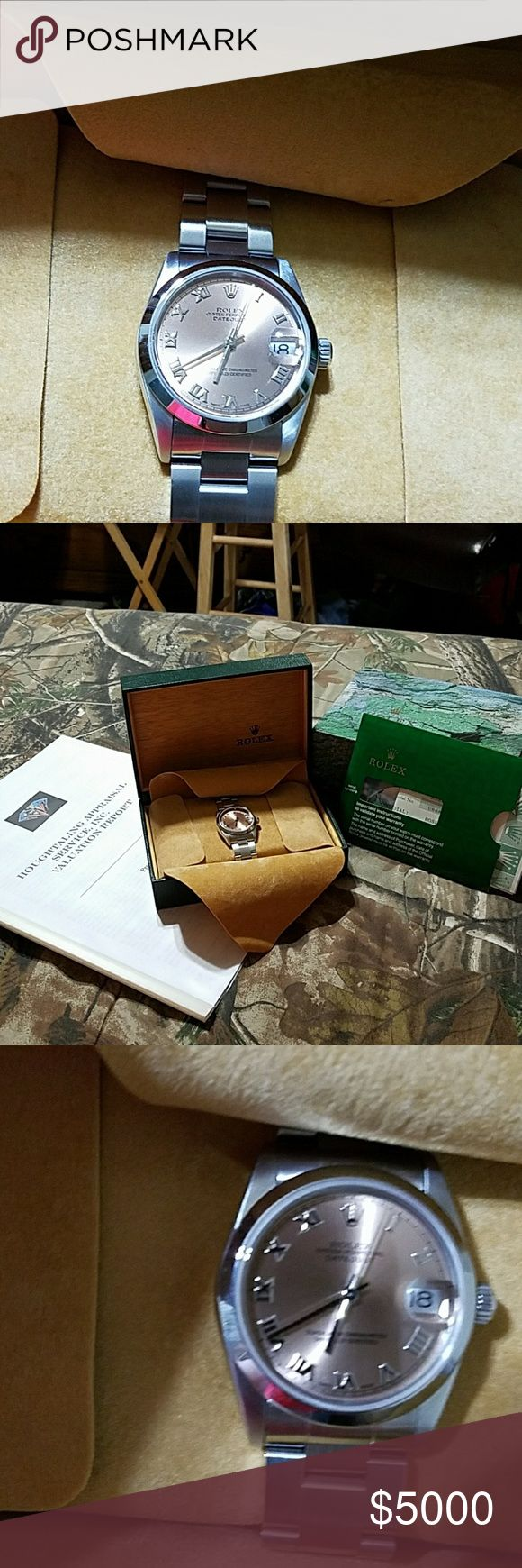 1998 ROLEX date adjust 31mm AUTHENTIC 1998 ROLEX WITH Rose colored face and Roman numerals. Midsize 31mm. Excellent condition. Stainless steel band. Has a scratch on band buckle. Original box and papers along with recent insurance appraisal. AUTHENTIC ROLEX. Price has some room for negotiations. FYI- Up until around 2000 or later Rolex only offered a 1 year warranty on their watches. After then it went to 2 years, 3 and now 5 years. JUST COVERING THE BASICS. ALSO LISTED ON EBAY…