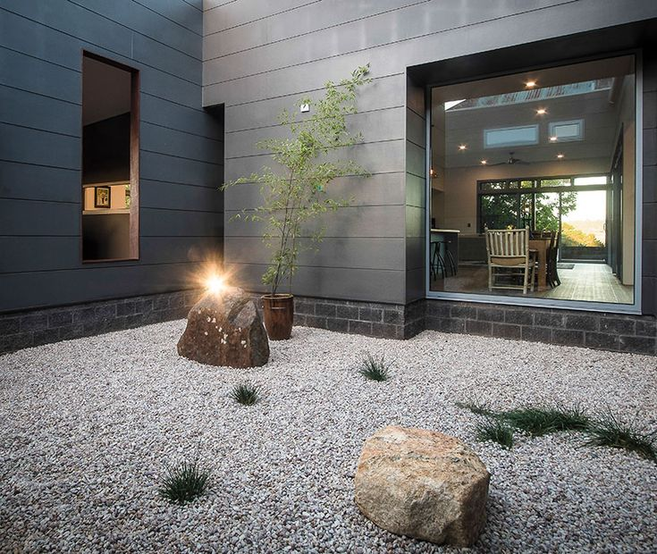 The key to achieving a balanced look is ensuring a larger portion of your exterior is minimalistic. This can be achieved with simple colours and textures like in this modern home.
