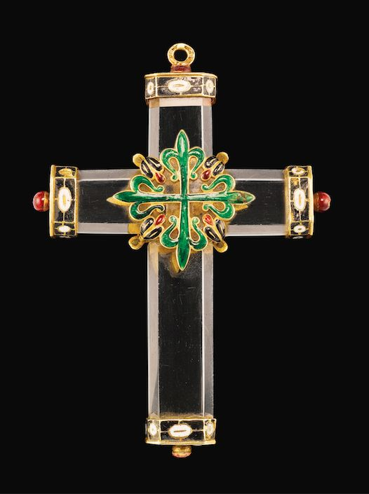 SPANISH, CIRCA 1620 PENDANT CROSS mounted with the Greek cross of the Knights of order of Alcántara, the terminals adorned with the cross of the Knights of St John rock crystal, with enamelled gold mounts 8.7cm., 3 3/8 in. overall.
