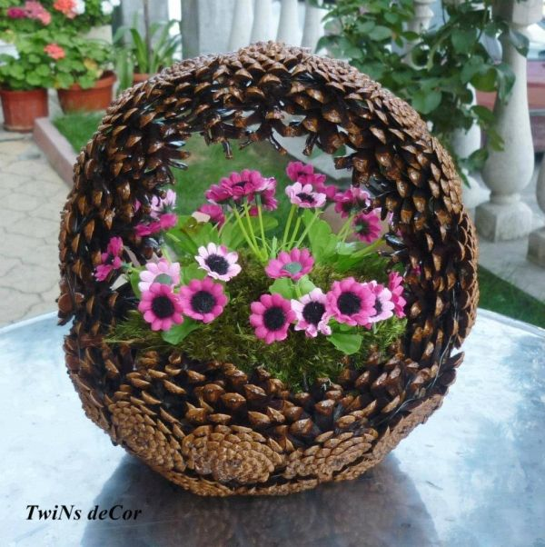 Cute pine cone basket with pink and green flowers, by pilar laguna