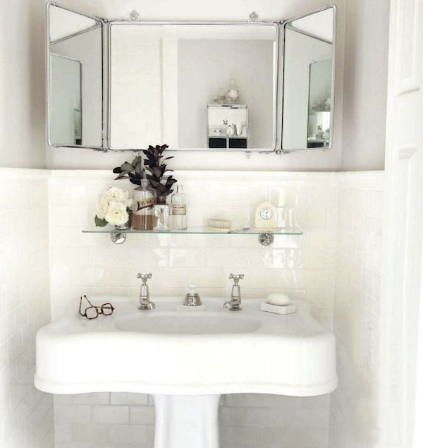 Chic Small Powder Room With Glossy White Pedestal Sink Subway Tiles Backsplash With Pencil