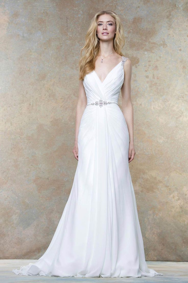 A glamorous beach wedding dress from Ellis Bridals that has a V-neckline and flattering ruching