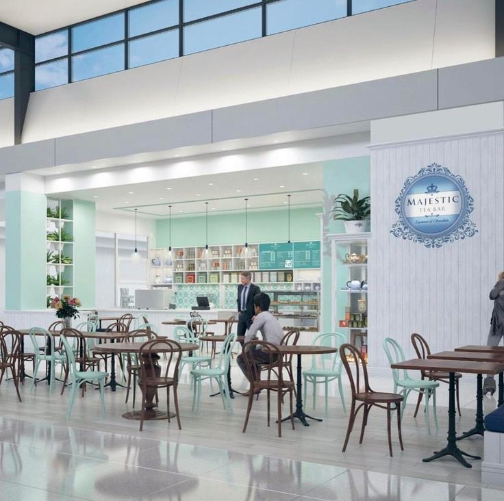 A fresh tea house design with white panelwork, backlit signage, soft pallette of colours.