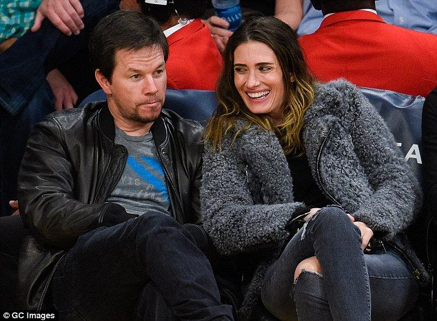 Game faces: Mark Wahlberg and his wife Rhea Durham had prime seats on Friday for…