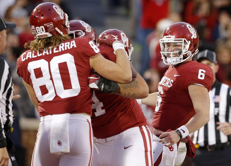 Oklahoma's Baker Mayfield (6) runs to celebrate after throwing a touchdown during a college football game between the Oklahoma Sooners (OU) and the West Virginia Mountaineers at Gaylord Family-Oklahoma Memorial Stadium in Norman, Okla., Saturday, Nov. 25, 2017. Oklahoma won 59-31. Photo by Bryan Terry, The Oklahoman