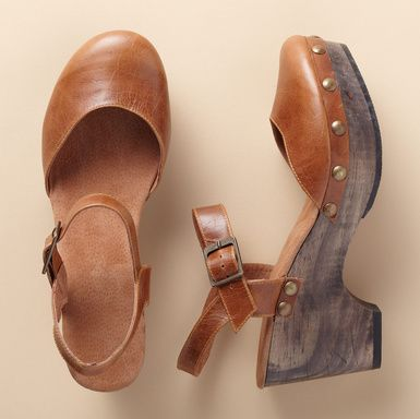 "MARIKA SANDALS -- Mary Jane meets the clog, in chestnut vegetable-tanned leather with the iconic ankle strap and a polished wood platform wedge. Cushioned leather insole, rubber sole. Imported. Euro whole sizes 36 to 41. 36 (US 6), 37 (US 7), 38 (US 8), 39 (US 9), 40 (US 10), 41 (US 11). 2-3/4"" wedge on 1"" platform."