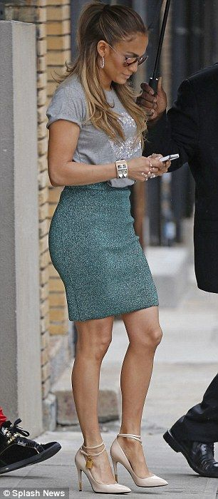 Chic combo: The I Luh Ya Papi star donned a skin-tight textured high waisted green skit that showed off her famous derriere with a loose fit grey t-shirt that had a giant pair of lips on front...