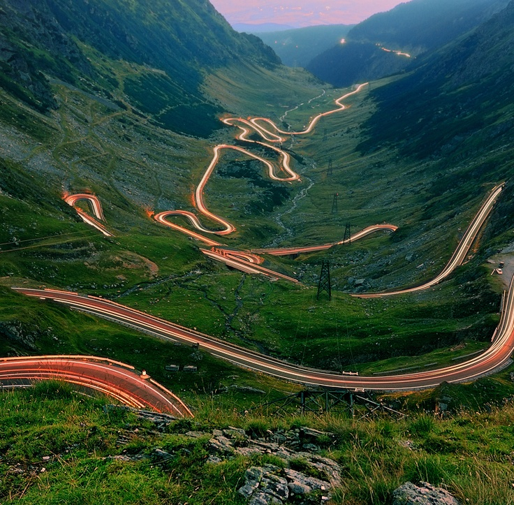 The Transfăgărășan (Ceaușescu's folly)-- Built as a strategic military route, the 90 km of twists and turns run north to south across the tallest sections of the Southern Carpathians, between the highest peak in the country, Moldoveanu, and the second highest, Negoiu. The road connects the historic regions of Transylvania and Wallachia, and the cities of Sibiu and Pitești.