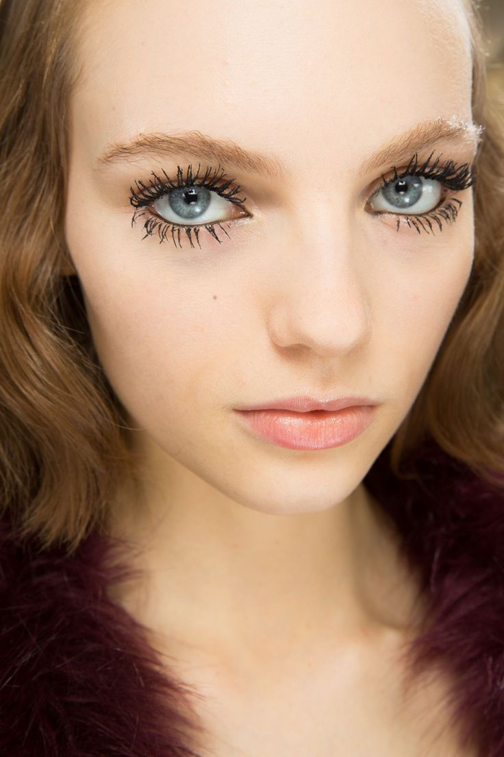 Spidery lashes and kohl-lined eyes were the focus of the beauty look by Peter Philips at Dior.