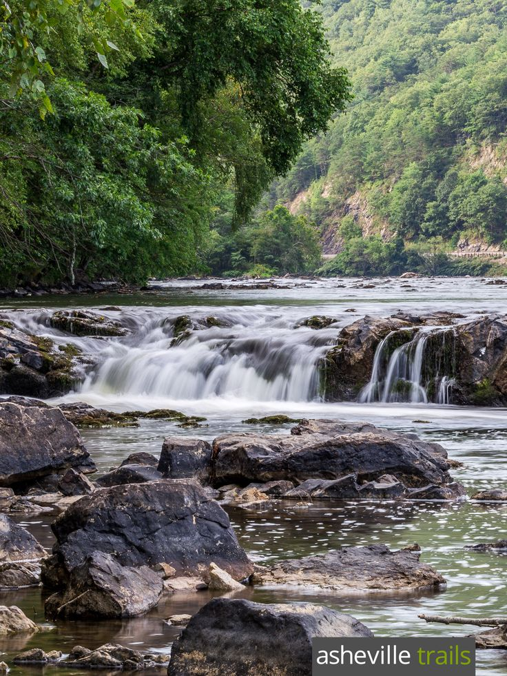 Hike the Appalachian Trail in Hot Springs, NC, visiting a tumbling waterfall on the French Broad River