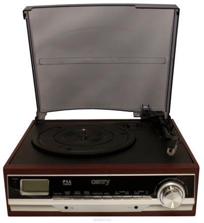 Camry 1113, Black ретро-проигрыватель  — 8031 руб. —  Ретро-проигрыватель Camry CR1113 с AM/FM-радиоприемником. Он способен проигрывать мелодии с пластинок на 3 скоростях. Для удобства прослушивания композиций, имеются небольшие динамики, встроенные в корпус. Микролифт тонарма ЖК-дисплей PLL радио Мощность динамиков 3Вт