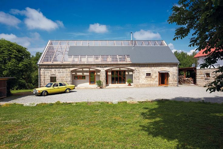 a renovated old barn offers tons of light, while keeping the old charm