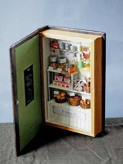 how cute is this little bakery window in a hollowed out book?